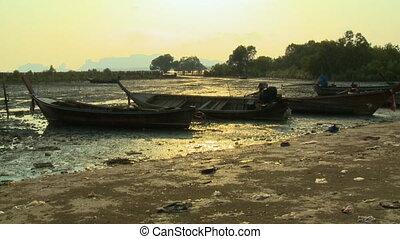 Boats Beached on Trash Filled Land - Handheld, medium wide...