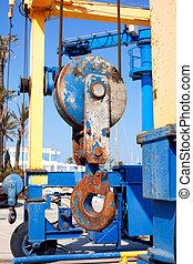 boats crane hook pulley rusty detail on marina port