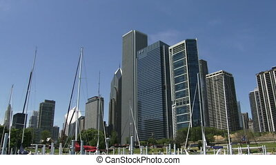 Boats docked at Chicago Yacht Club, with view of city...
