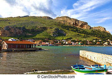 Sicily - Boats docked in a small harbor in a fishing village...