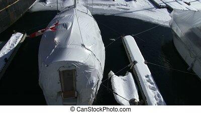 Boats docked on frozen water