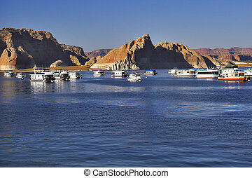 Boats expect tourists - Walking boats on lake Powell in the...