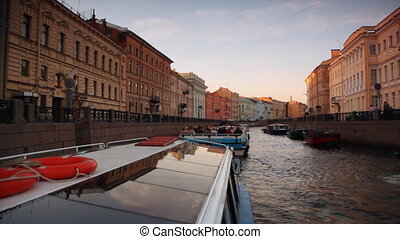 Boats float on river channel to St. Petersburg