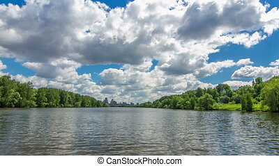 Boats floats on the Moskva River past the Zhivopisny Bridge...