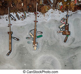 Boats frozen in the water on a lake