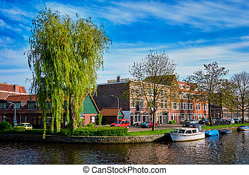 Boats, houses and canal. Harlem, Netherlands - Boats and ...