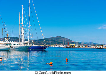 Boats in Alghero harbor on a clear summer day