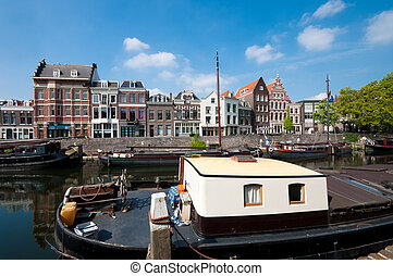 boats in canal - houseboats and barges in canal in...