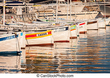 Boats in docks in Cassis - Row of colourful boats in the ...