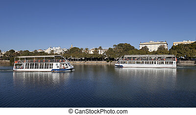 Boats in Guadalquivir river, Seville, Andalusia, Spain