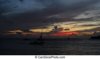 Boats In Key West Sunset - Silhouetted motorboats and...
