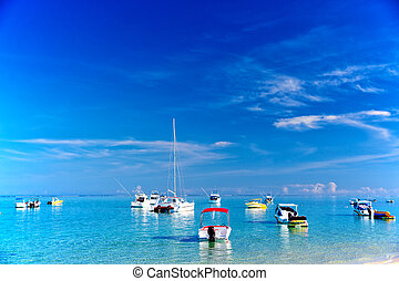 Boats in Mauritius - Catamaran and boats in turquoise sea of...