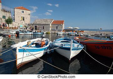 boats in the harbor fishing village horizontal