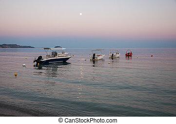 Boats in the Laganas bay at dusk