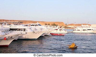 Boats in the marina - Passing by  boat and yacht marina.