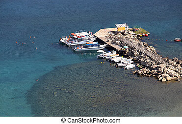 boats in the sea near the pier