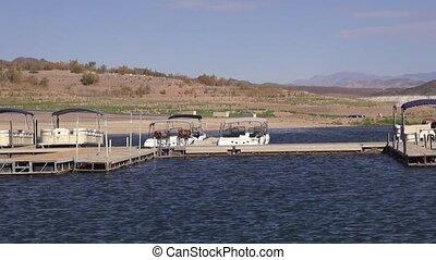 Boats, jet boats at a harbor, docks