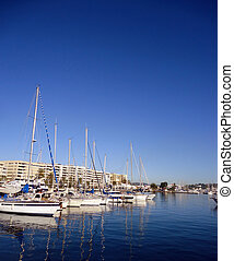 Boats marina port in blue summer day at Ibiza