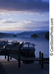 Boats moored at a pier in the Lake District
