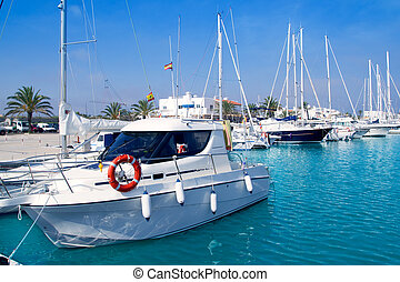boats moored in Formentera marina with turquoise sea