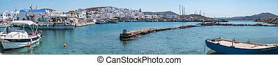 Boats moored in Mykonos harbor panorama view