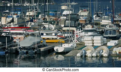 Boats Moored In The Bay - Floating harbor with yachts and...