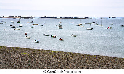 boats moored near pebble beach in Ploubazlanec