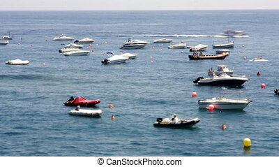 boats moored out at sea in tossa del mar, spain