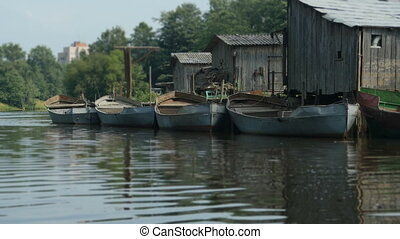 Boats moored to old barns - Fishing boats moored to the old...