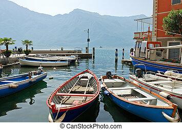 boats near pier in town limone sul garda, Lake Garda, Italy