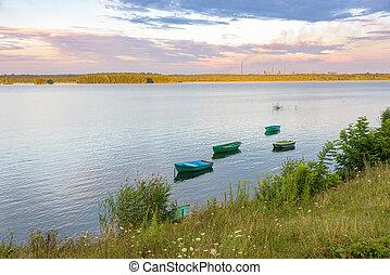 Boats on a lake at sunset