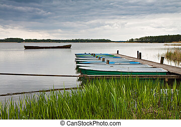Boats on a lake in the Mark Brandenburg (Germany).