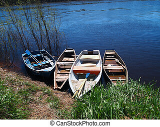 Boats on a shore of a river
