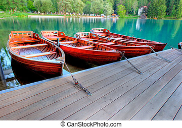 Boats on alpine lake in early morning