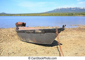boats on bank of lake