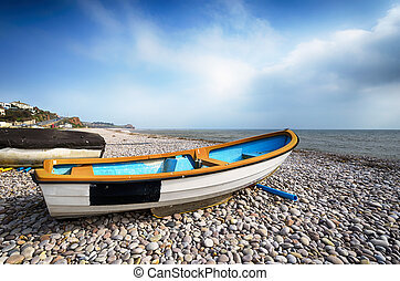 Boats on the beach at Budleigh Salterton in Devon