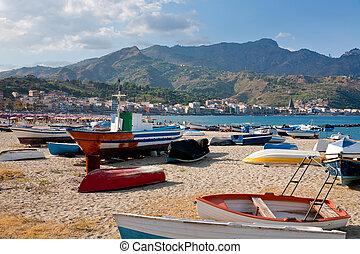 boats on beach Giardini Naxos in summer day, Sicily -...