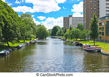 Boats on canal in park in Amsterdam. Netherlands
