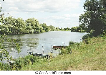 Boats on Havel river in summer time (Havelland, Germany)