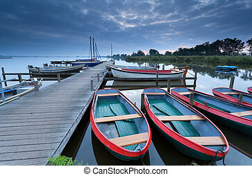 boats on lake harbor in dusk, Leekstermeer, Netherlands