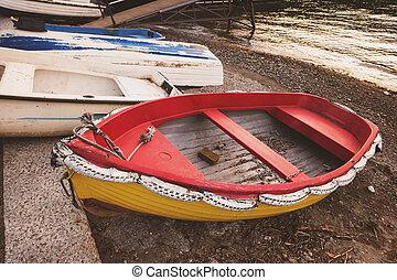 Boats on lake shore.