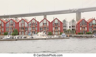 Boats on moorage at village near huge pendant bridge - Boats...