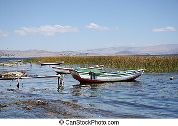 Boats on shore of Titicaca Lake