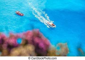 boats on the azure sea against flowers