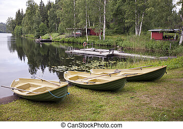 Boats on the bank of the forest lake. Finland