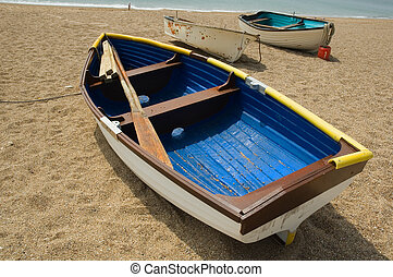 boats on the beach - beach scene with a group of small boats...