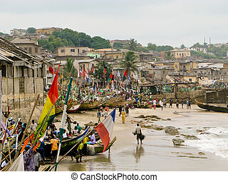 Fishermen and colorful boats on beach near Accra in Ghana in West Africa