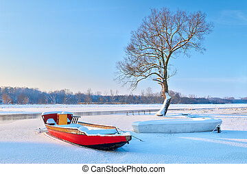 Boats on the frozen river.
