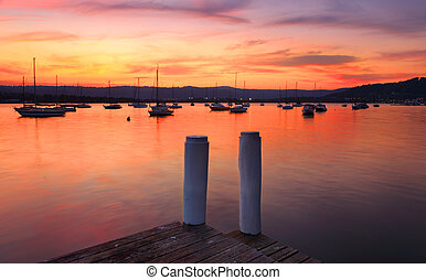 Boats on the harbour at sunset - Boats and yachts on the...