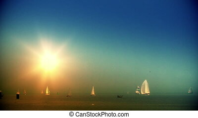 Boats on the horizon at sunset
